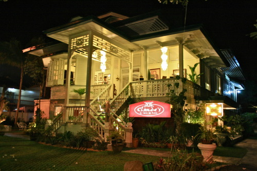 Claude's le Cafe de Ville, Davao City, Philippines I wanted to include this picture separately because I have an inclination for old things. We were walking about the city after a day's work and after rows of commercial concrete buildings popped this elegant infrastructure. It is an old house built in the 1920's which was preserved and converted into a fine dining restaurant with a European cuisine. Unfortunately, we were not able to try out the food as we did not have enough budget but we were able to meet the great grandchild of the house's owner who informed us that we have to allot at least 1,500 to eat at the restaurant. :p