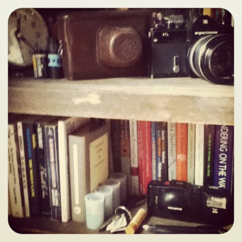 amble:  Organized my bookshelf today :) (Taken with instagram)  hmm… i got camera envy.