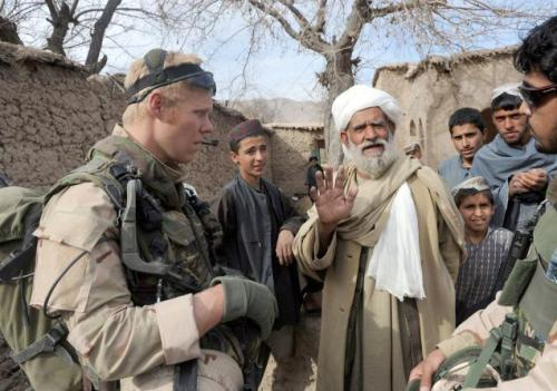 A Dutch soldier with Afghans during a patrol in Chora valley in Afghanistan's southern Uruzgan province. Photo: AFP