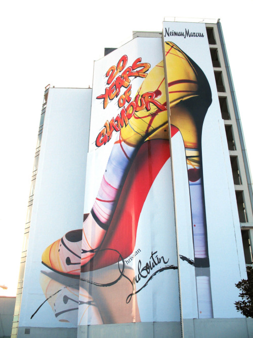 "Commemorating Christian Louboutin's 20th Anniversary with a billboard, in Los Angeles, created by graffiti artist Galo ""Make"" Canote."