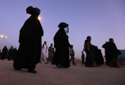 رايحين لكربلا @AP Shiite pilgrims march on their way to Karbala  for Arbaeen, in western #Baghdad, #Iraq, Thursday, Jan. 12, 2012. The  holiday marks the end of the forty day mourning period after the  anniversary of the 7th century martyrdom of Imam Hussein the Prophet Mohammed.