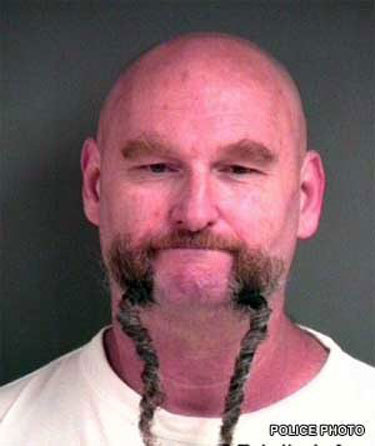 MUGSHOT BEARD!!! I LOVE THE COMBO HERE OF BEARD AND BRAID  THIS GUY MUST HAVE BEEN FRAMED BECAUSE HE LOOKS TOTALLY TRUSTWORTHY