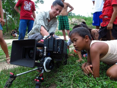Local children from a secluded village in Indonesian Borneo see for the first time a filming crew and video cameras. The crew have come to work with the village and film their plight against palm oil plantations - telling their story to the world.