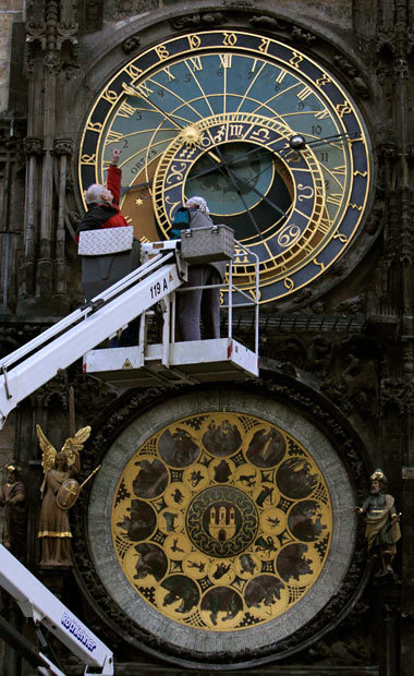 Prague, Czech Republic Workers prepare to remove a wooden sculptural decoration from the Astronomical Clock at the Old Town Square (via Telegraph)