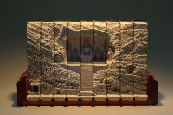 Amazing carved book landscapes……     For the better part of three decades multidisciplinary artist Guy Laramee has worked as a stage writer, director, composer, a fabricator of musical instruments, a singer, sculptor, painter and writer. Among his sculptural works are two incredible series of carved book landscapes and structures entitled Biblios and The Great Wall, where the dense pages of old books are excavated to reveal serene mountains, plateaus, and ancient structures. Of these works he says:  So I carve landscapes out of books and I paint Romantic landscapes. Mountains of disused knowledge return to what they really are: mountains. They erode a bit more and they become hills. Then they flatten and become fields where apparently nothing is happening. Piles of obsolete encyclopedias return to that which does not need to say anything, that which simply IS. Fogs and clouds erase everything we know, everything we think we are.  Laramee's next show will be in April of 2012 at the Galerie d'Art d'Outremont in Montreal.