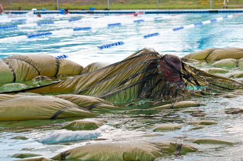 Water survival training by The U.S. Army on Flickr.A Soldier with the Headquarters and Headquarters Company, U.S. Army Civil Affairs and Psychological Operations Command (Airborne) follows a radial seam underwater to simulate getting out from underneath a canopy after a water parachute landing during water survival training at their battle assembly, Sept. 10. U.S. Army Photo by Staff Sgt. Sharilyn Wells
