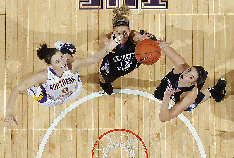 Northern Iowa's Amber Kirschbaum (0) battles for a rebound with Indiana State's Deja Mattox, center, and Shannon Thomas, right, in the first half of an NCAA college basketball game, Thursday, Jan. 12, 2012, in Cedar Falls, Iowa. Indiana State won 68-62. (Photo by Matthew Putney) (via Photos: Sports Day in Pictures | Denver Post Media Center)