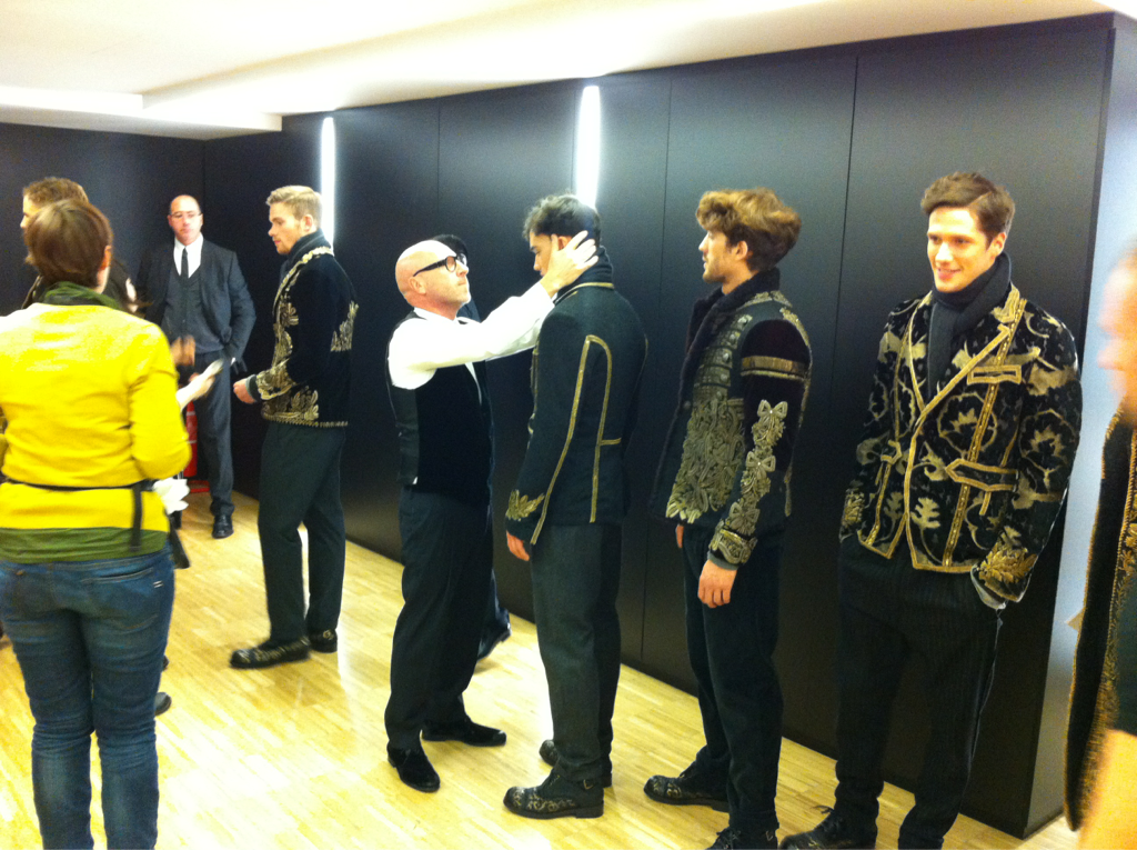 Finishing touches from Domenico Dolce, backstage at the Dolce & Gabbana show