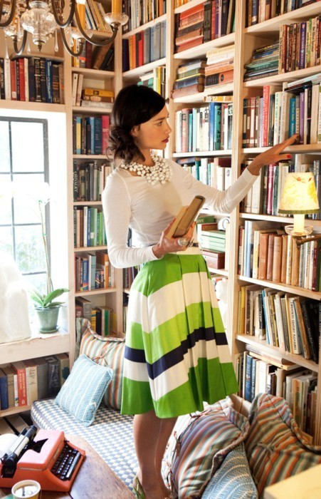 I love messy libraries. That skirt, too.