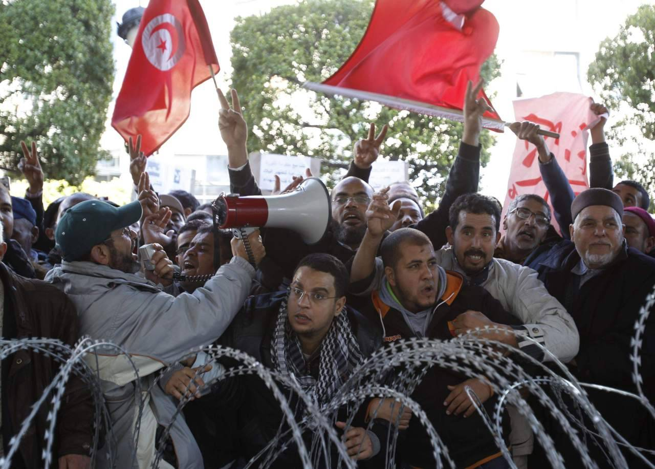 "Tunisians feel pride, despair on revolt anniversary  Tarak Amara for Reuters - As a symbol of how far Tunisia still has to go to fulfill the promise of the first Arab Spring revolution, Ammar Gharsallah's death this week could hardly have been more poignant.  The 40-year-old father of three, despairing at his poverty, died after immolating himself with petrol, echoing the act of the Tunisian vegetable vendor who one year ago set off a wave of revolt that has not yet abated. Tunisia will on Saturday hold celebrations in the capital to mark one year from the day when protests forced autocratic leader Zine al-Abidine Ben Ali to flee the country, and gave birth to the ""Arab Spring"" uprising"