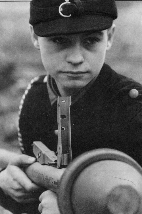 "ausschreitungen:  A boy of the Hitler Youth, armed with a grenade ""pantserfaust."" The so-called ""last hope of the Third Reich."""