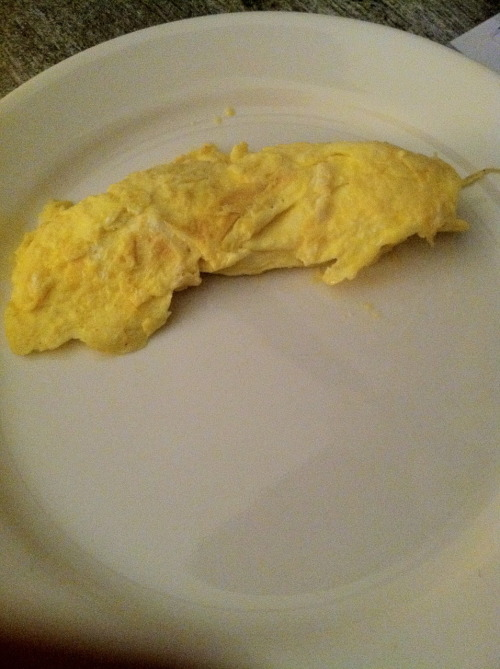Omelet, round 4 Definitely the CUTEST omelet I've made thus far. I feel like I've kind of turned a corner. I understand the butter. I've browned it. I've taken it to the point where it just about browns and that's where it has to be for these omelets. (Just like it is instructed in the text.) I don't understand the technique though. With this omelet, I utilized the fork the most. Not the pan. I know the book says that I can develop my own style of making omelets. So, whatever. Take my fork-made omelets like a bitch!
