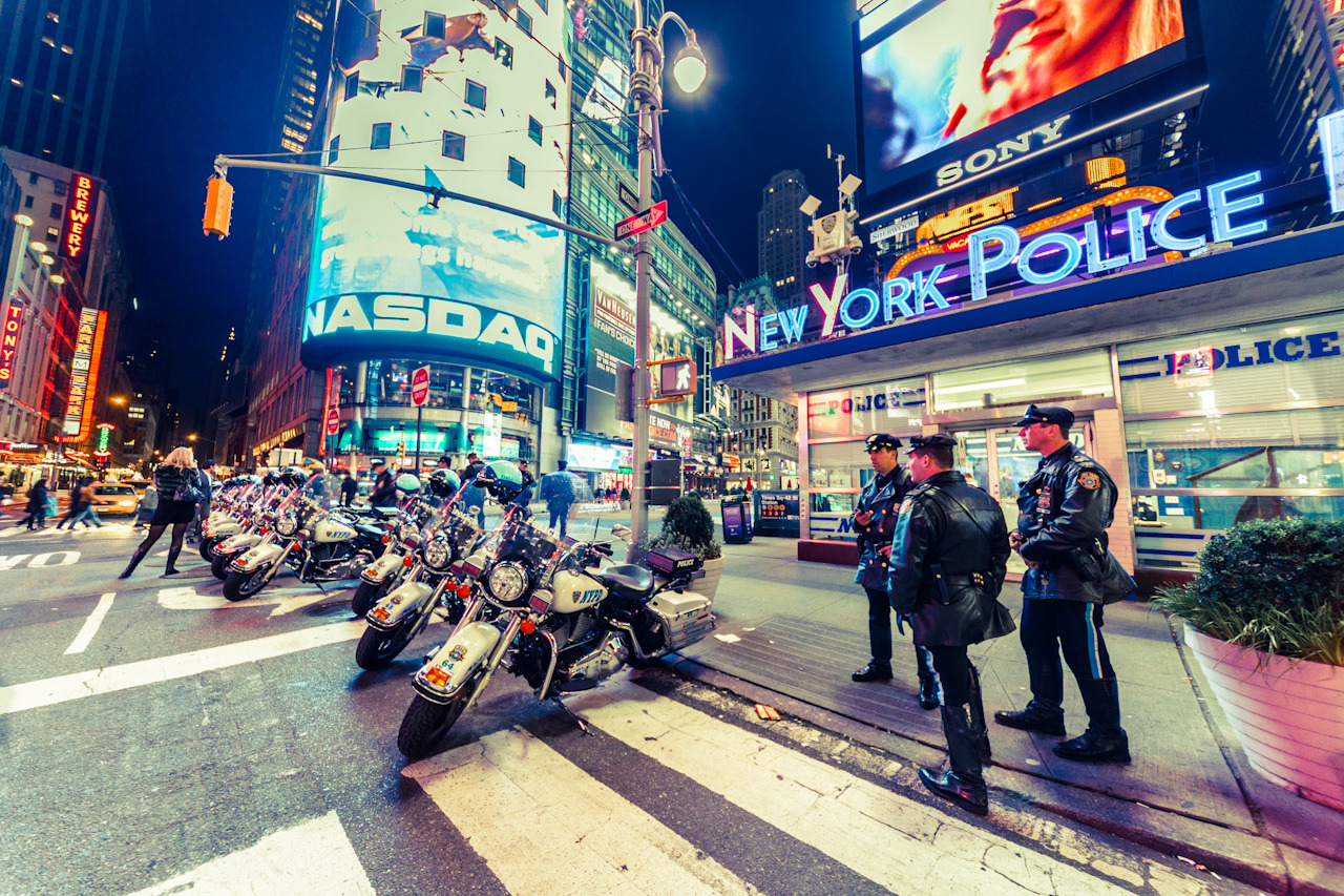"New York Police at Times Square on Flickr. ""A bunch of police motorcycles and officers at Times Square."" Lightroom 4 Beta was recently released so I had to try out the new processing model that Adobe has moved to. Nice but all my presets don't work anymore :("