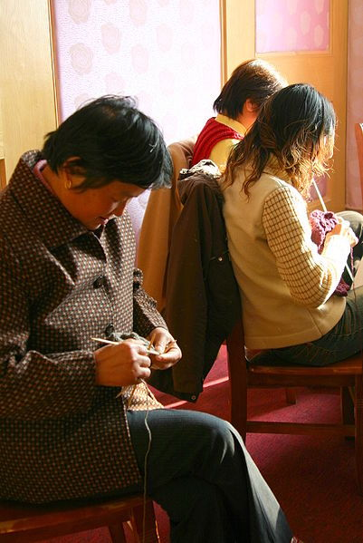 Knitters creating hand-knit Shokay products using yarn made from Tibetan yak down. Photo  by Danielle Fay