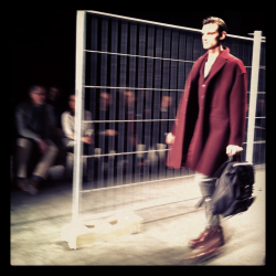 Oversized coats, industrial setting at Neil Barrett