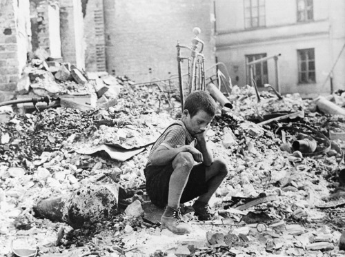 picturesofwar:  A young Polish boy returns to what was his home and squats among the ruins during a pause in the German air raids. Warsaw, Poland - September, 1939. (AP Photo/Julien Bryan)