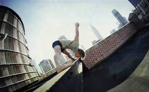 yogadudes:  Adam Ringer on Manhattan`s rooftop, New York by Wari Om Photography on Flickr.