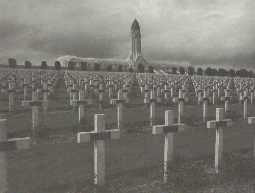 "The bones of thousands of unidentifiable French and German soldiers were entombed in this tower at a French military cemetery in Verdun. The ossuaire (""charnel-house"") of Verdun embodies the terrible human cost of World War I."