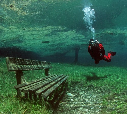This is the Green Lake in Tragoess, Styria, which sits at the foot of snow-capped Hochschwab mountains. Throughout the frozen winter months the area is almost completely dry and is used as a county park. It is a particular favourite site for hikers.  But as soon as the temperatures begin to rise in spring, the ice and snow on the mountaintops begins to melt and runs down into the basin of land below.  The park fills up with ice-cold crystal clear water, which gets its distinctive green colouring from the grass and foliage beneath. The water levels rise from about one or two metres deep in the winter to as much as 10 metres in the late spring and early summer. The waters are at their highest in June when it becomes a mecca for divers keen to explore the rare phenomenon, before the waters recede at the end of July.