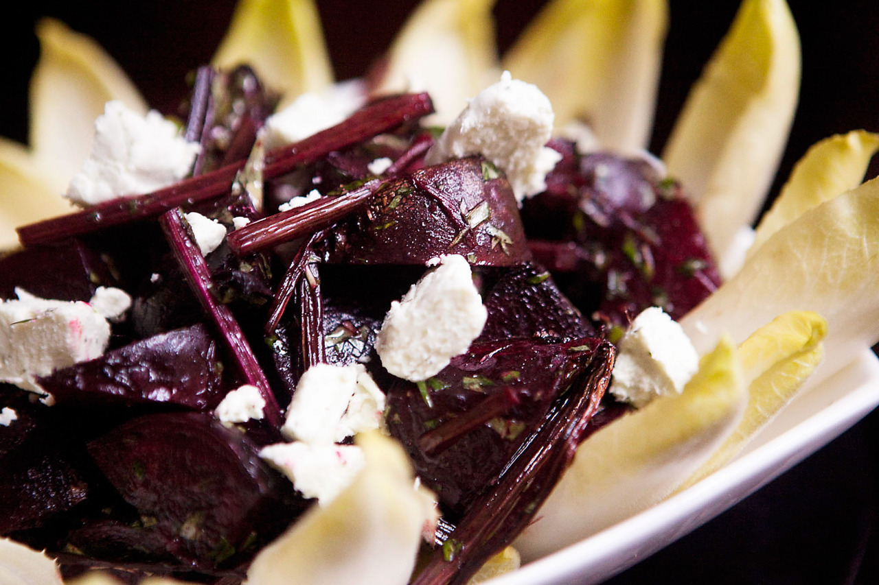 Beetroot, Goat's Cheese and Mint Salad Quarter washed, raw beetroot and roast, tossed in olive oil, salt and pepper, for 30 minutes.  Refrigerate, and once cool, toss with 1/4 cup chopped mint.  Top with goat's cheese, and serve on witlof leaves.