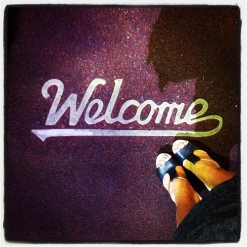 Happy feet welcome mat. #lomofi #welcome #feetshot #familydinner #stupidshadow #sunday #iphoneasia #jj #iphone4 #iphoneonly #iphoneography  (Taken with Instagram at Luk Foo)