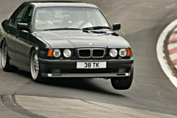 bimmers:  BMW 5er E34 attacking the Karussell Schwalbenschwanz at the Nurburgring PS: thanks carmonday for the tip!