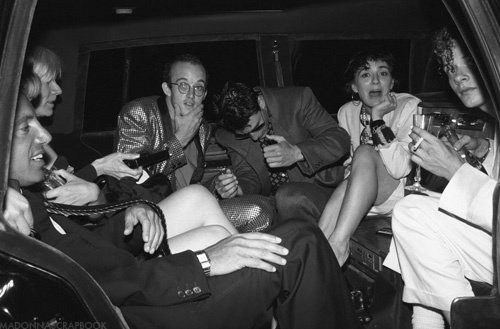 Steve Rubell, Andy Warhol, Keith Haring, Tom Cruise, Maripol and Martin Burgoyne in limo for Madonna's wedding to Sean Penn 1985.