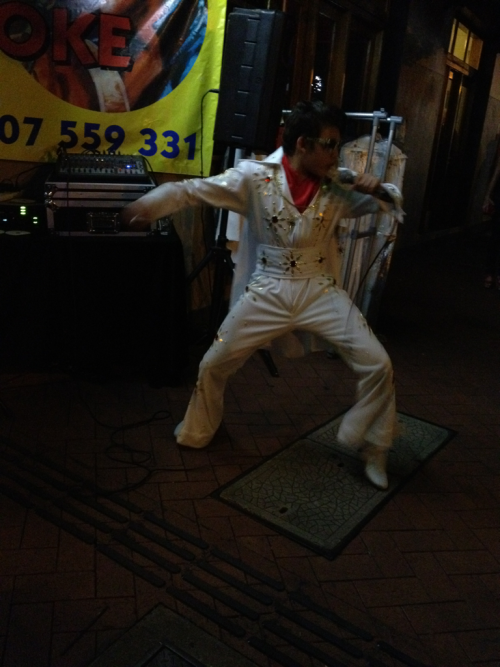 A wee Elvis rips it out on the sidewalk at the Parkes Elvis Fest.