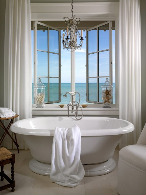 A dreamy and romantic bathroom with a stellar ocean view (via Jill Shevlin - Intrinsic Designs)
