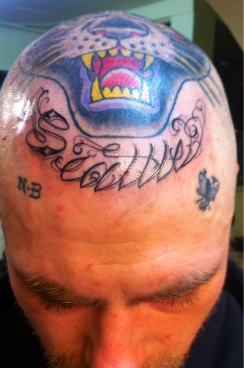 bikesandtattoos:  New Seattle head tattoo done by Eddie Martinez at Super Genius Tattoo Seattle. Hood as fuck.