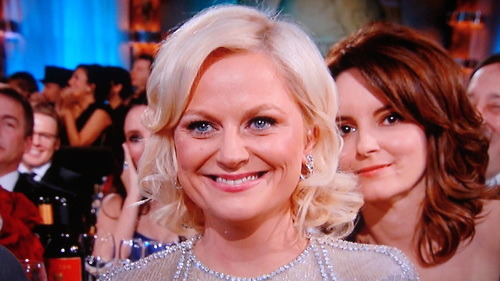 Tina Fey just photo bombed Amy Poehler.  This is why I love them!