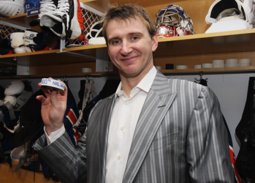 ilovegoalies:  Evgeni Nabokov of the New York Islanders poses with the game puck after getting his 300th career victory against the Buffalo Sabres on January 14, 2012