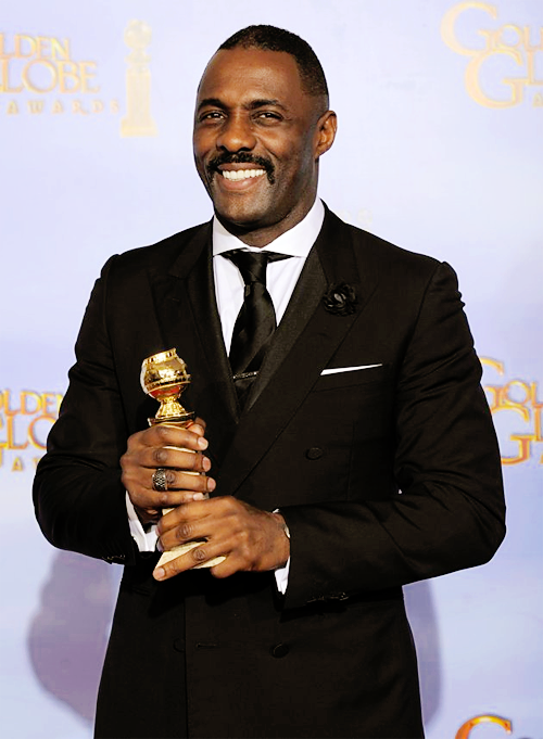 A be-tuxedoed Idris Elba accepts his Golden Globe for Best Catullus Graves Portrayal.