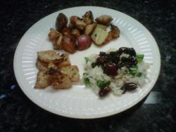 Rosemary chicken and roasted red potatoes, parmesan turnips with a hint of cayenne pepper and nutmeg. And my newest creation spinach rice with an olive and raisin white wine reduction.
