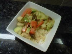 Coconut curry chicken with shiitake mushrooms avocado and carrots over jasmine rice.