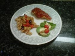Chicken parmesan with a tomato, zucchini and kalamata olive pasta tossed with garlic, olive oil and basil. With a spinach & mozzarella salad drizzled with balsamic vinaigrette. This one was good.