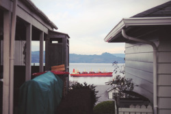 Houses and a red boat. Astoria, Oregon
