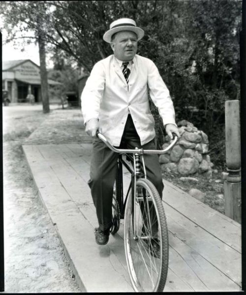 W. C. Fields rides a bike.