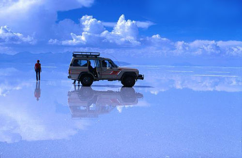 "islamicthinking:  #Subhannallah. The world's largest salt flat is located in Salar de' Uyuni, Bolivia. During the rainy season, the water turns into the world's largest mirror. The reflection of the sky creates a sense of infinity, like you're walking among the clouds. Its known as the ""Borderline between Heaven and Earth"""