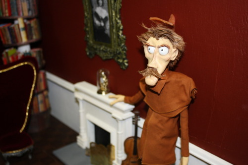"Photo of the Day:Introducing, the Detective! The third and final puppet is finally complete. He is the ""misinformed"" portion of  the trio, and has no problem hounding the poor Butler about crimes he did or did not commit.  Like the Butler and Old Man his finishing touches will include skin-toned clay to  make  adjustable eyelids. Filming is in its last week of production, and we're hoping to begin all of our colour correction and After Effects work next week! We'll be posting updates during that time on what we're doing, problems we encounter, and explanations on masking out puppet rigs and more!"
