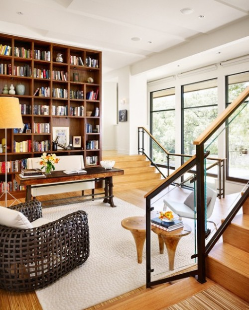 A classy step-down home library pairs traditional and modern furnishings in a contemporary setting (via Hugh Jefferson Randolph Architects)