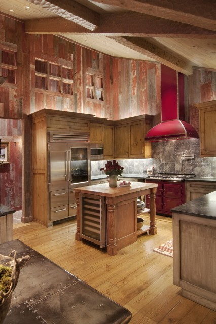 The rustic kitchen in this Lake Tahoe home features walls of distressed, reclaimed barn wood (via Ward-Young Architecture & Planning)