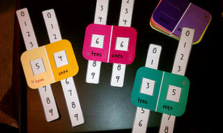 ambedu:  Another classroom application for paint chips, this time with a math emphasis [from Tattling To the Teacher ]. You could use larger paint chips with more variants of colors to convey larger numbers.
