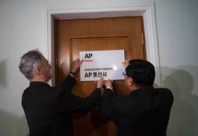 "AP: Next Stop, North Korea The AP opens first Western news bureau in North Korea. Via the Associated Press:  The Associated Press opened its newest bureau here Monday, becoming the first international news organization with a full-time presence to cover news from North Korea in words, pictures and video. In a ceremony that came less than a month after the death of longtime ruler Kim Jong Il and capped nearly a year of discussions, AP President and CEO Tom Curley and a delegation of top AP editors inaugurated the office, situated inside the headquarters of the state-run Korean Central News Agency in downtown Pyongyang… …The bureau puts AP in a position to document the people, places and politics of North Korea across all media platforms at a critical moment in its history, with Kim's death and the ascension of his young son as the country's new leader, Curley said in remarks prepared for the opening. ""Beyond this door lies a path to vastly larger understanding and cultural enrichment for millions around the world,"" Curley said. ""Regardless of whether you were born in Pyongyang or Pennsylvania, you are aware of the bridge being created today."" Curley said the Pyongyang bureau will operate under the same standards and practices as AP bureaus worldwide. ""Everyone at The Associated Press takes his or her responsibilities of a free and fair press with utmost seriousness,"" he said. ""We pledge to do our best to reflect accurately the people of the Democratic People's Republic of Korea as well as what they do and say.""  Image: Associated Press President Tom Curley, left, and Korean Central News Agency President Kim Pyong Ho hang the Associated Press Pyongyang sign on the door to open a new AP bureau in Pyongyang, North Korea on Monday Jan. 16, 2012. Via the AP."