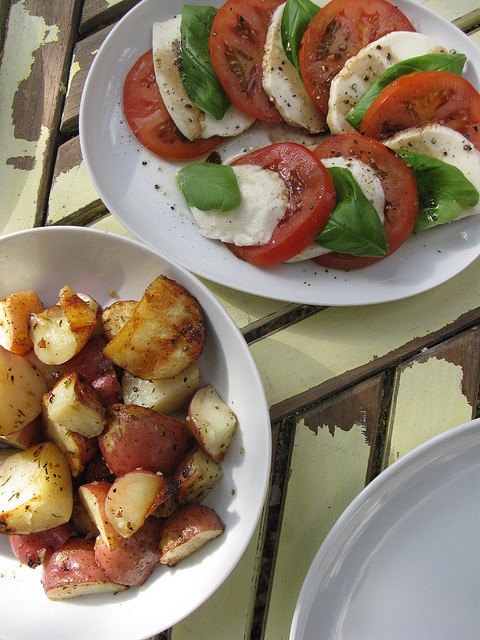 phagosome:  Grilled potatoes, caprese salad. by Allison Newhouse on Flickr.