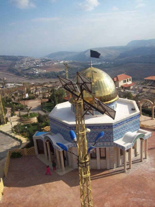 Dome of The Rock replica in Maroun el-Ras, some .62 mi. from occupied Palestine; fully functional house of prayer. It uses solar/wind power.