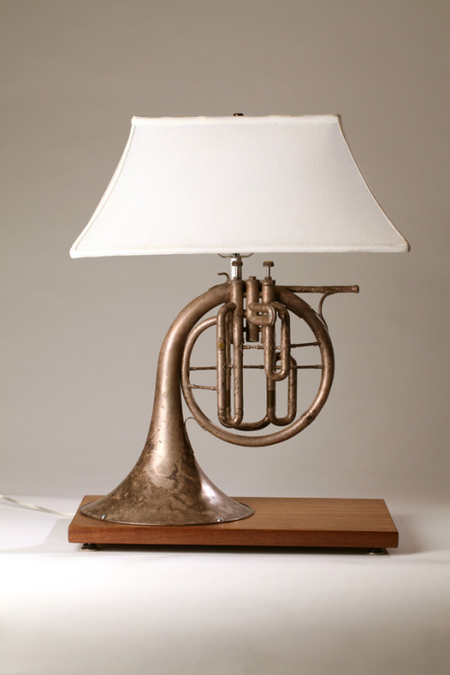 unconsumption:  pottsvillain:  Made this lamp for my music room a few years ago.  Used French horn from local antique store, old walnut plank and a shade from an old lamp that I had.  Made the base to mirror the size of the shade.  Nice! We at Unconsumption love coming across examples of music-related repurposing.