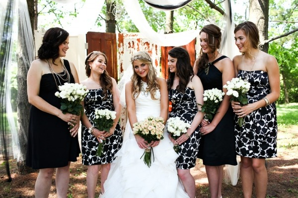 This is a perfect example of being able to mix and match your bridal party's attire.  Not only can you have different solid colors, but you can also mix the patterns as well as silhouettes.  Photography: Lauren Gabrielle