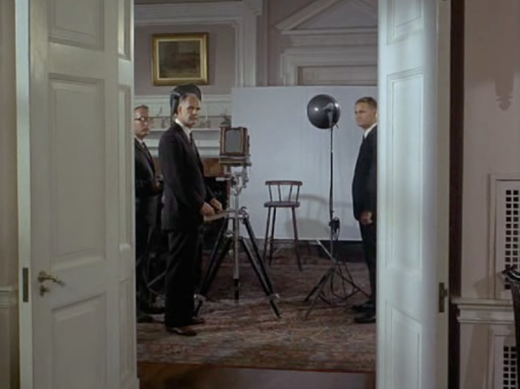 A 4x5 camera in Hitchcock's 1969 spy thriller, Topaz. When the Russian defector and his family arrive at the safe house outside Washington they are quickly led in to a make-shift studio for their portraits. There are so many interesting cameras in this movie that I will spread them over a few posts. More later…