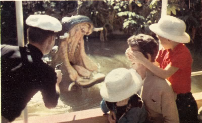 thruwaltseyes:  A skipper scares off some hippos on the Jungle Cruise.